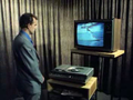 Man with laserdisc player and television.png