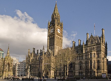 Manchester Town Hall in Albert Square, seat of local government, is an example of Victorian era Gothic revival architecture. Manchester Town Hall from Lloyd St.jpg