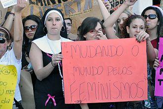 "SlutWalk - Marcha das Vadias in Brasília, on June 18, 2011. The sign reads: ""Changing the world through Feminisms"""