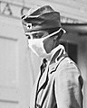 Mask detail, 1918 flu outbreak RedCrossLitterCarriersSpanishFluWashingtonDC (cropped).jpg