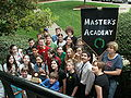 Master's Academy Delegation with banner 1.JPG