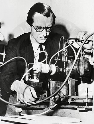Maurice Wilkins - Maurice Wilkins with one of the cameras he developed specially for X-ray diffraction studies at King's College London
