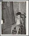 Mexican boy in corner of room. San Antonio, Texas.jpg
