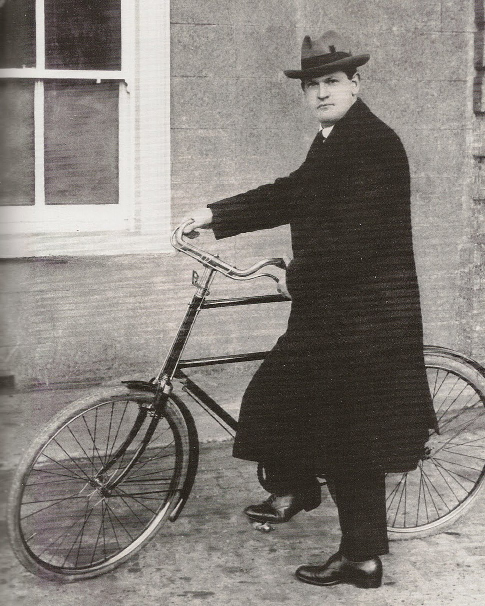 Michael Collins On Bicycle