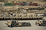 Military vehicles and accessory equipment fill a retrograde yard at Camp Warrior, Bagram Airfield, Afghanistan, Oct. 2, 2013, before being shipped from the base 131002-F-YL744-094.jpg