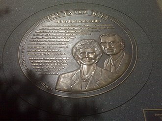 Millard Fuller - Millard and Linda Fuller honoree medallion located on The Extra Mile memorial beginning at the corner of Pennsylvania Avenue and 15th Street, NW and continues north on 15th Street to G Street, NW. There, it turns east on G Street for two blocks to its intersection with 13th Street, in Washington, DC.
