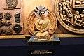Miniature statue of Acharya Nagarjuna displayed at Telugu Museum.jpg