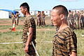 Mongolian service members get sprayed during a pepper spray qualification course as part of Non-Lethal Weapons Executive Seminar (NOLES) 13 at Five Hills Training Area, Mongolia, Aug. 21, 2013 130821-M-DR618-184.jpg