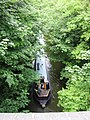 Narrowboat travelling north west along the Tring Summit cutting - geograph.org.uk - 1337849.jpg
