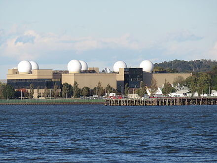 This building on NRL's main campus features prominent radomes on its roof. Naval Research Laboratory radomes 2015.JPG