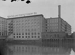 "Necco - The Necco complex in South Boston which had a sign, on the roof of the factory reading, ""New England Confectionary Co."", as seen from across the Fort Point Channel, circa 1902-1907."