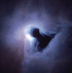 The reflection nebula NGC 1999 is brilliantly illuminated by V380 Orionis (center), a variable star with about 3.5 times the mass of the Sun. NASA image