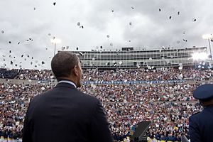 United States presidential election in Colorado, 2012 - On the campaign trail, President Obama watches as graduates toss their hats during the United States Air Force Academy commencement ceremony at Falcon Stadium, USAF Academy in Colorado Springs, Colorado. May 23, 2012.
