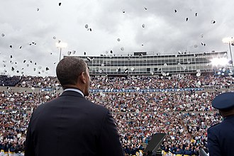 2012 United States presidential election in Colorado - On the campaign trail, President Obama watches as graduates toss their hats during the United States Air Force Academy commencement ceremony at Falcon Stadium, USAF Academy in Colorado Springs, Colorado. May 23, 2012.