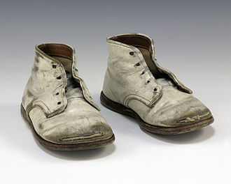 Operation Babylift - A pair of well-worn baby shoes worn by an orphan evacuated from Vietnam during Operation Babylift