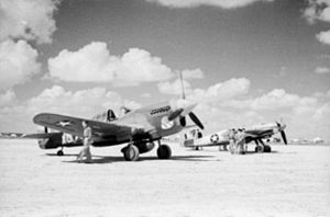 P-40F and captured Me 109G in Tunisia 1943.jpg