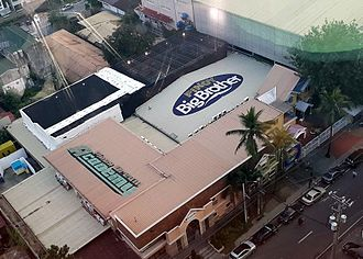 Pinoy Big Brother - The Pinoy Big Brother studios as seen from the 12th floor of ELJ Communications Center. On the lower left of the picture is the facade designed for the former reality television show Pinoy Dream Academy, on the upper left is the Pinoy Big Brother activity area, while on the upper right of the picture are the swimming pool area and the Pinoy Big Brother multi-purpose hall.