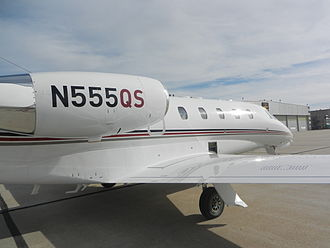 """NetJets - NetJets aircraft all wear this paint scheme, and those based in the US have the letters """"QS"""" painted on the tail number signifying Quarter Share."""