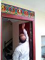 Pancha Buddha over doorway.jpg