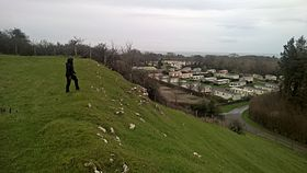 Parciau hill-fort ramparts and view north-east over caravan site to the Irish Sea.jpg