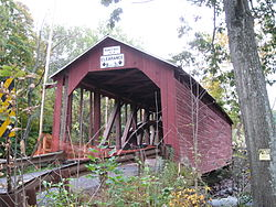 The north end of Parr's Mill Covered Bridge is in Franklin Township, and crosses the North Branch of Roaring Creek into Cleveland Township