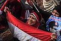 Participants hold flag and picture of Abdel Fateh el Sissi.jpg