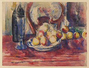 Pommes, bouteille et dossier de chaise