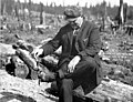Pedestrian sitting on a log, trying to separate himself from the Bothell Road Warrenite sticking to his shoes, Washington, May 8 (INDOCC 137).jpg