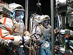 Performing all the pre-EVA and post-EVA airlock procedures with colleague Alex. (8147178654).jpg