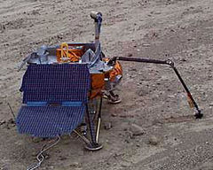 A prototype of the Phoenix lander practices robotic arm control at a test site in Death Valley.