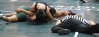 Scholastic wrestling - Securing the fall, or pinning, is the supreme goal in all wrestling, as it also scores the most points in team competitions. This near fall situation is about to turn into a fall in three seconds.
