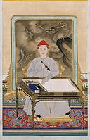 Portrait of the Kangxi Emperor in Informal Dress Holding a Brush.jpg