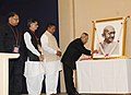 Pranab Mukherjee paying floral tributes at the portrait of Mahatma Gandhi, at the launch of 'Khadi Mark', in New Delhi. The Minister of State (Independent Charge) for Micro, Small & Medium Enterprises, Shri K.H. Muniyappa.jpg