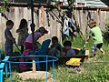 Preschoolers gathered around sandbox.jpg
