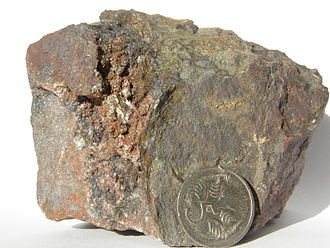 Iron oxide copper gold ore deposits - Chalcopyrite in hematised breccia from Prominent Hill
