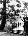 Qui Si Sana Sanatorium and Biological Institution showing Dr Louis Dechmann standing on pavilion porch viewing Lake Crescent (WASTATE 1577).jpeg