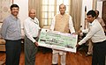 R.K. Mathur presenting a cheque of over Rs. 10 Lakhs 41 thousand as contribution towards the Prime Minister's Relief Fund to the Union Minister for Finance, Corporate Affairs and Defence, Shri Arun Jaitley.jpg