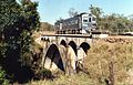 RM 1901 crossing a 1908 cast concrete bridge near Gayndah, one of the first such structure in Queensland.jpg