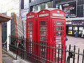Red phone boxes in Leicester Square, London (4039966446).jpg