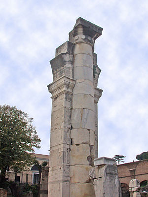 Basilica Julia - The reconstructed remains of a center column with support. The flaring at the top is the beginning of arches for the bottom tier
