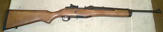 Ruger Mini-14 - Ranch Rifle. Note: scope mounts and ghost ring rear sight