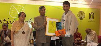 Suman Pokhrel - Pokhrel receiving SAARC Literary Award 2013