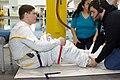 STS-123 training Behnken dons EMU.jpg