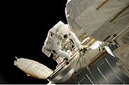 STS117 Reilly Enters Quest Airlock