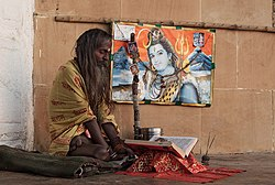 Sadhu and a picture of Siva.jpg