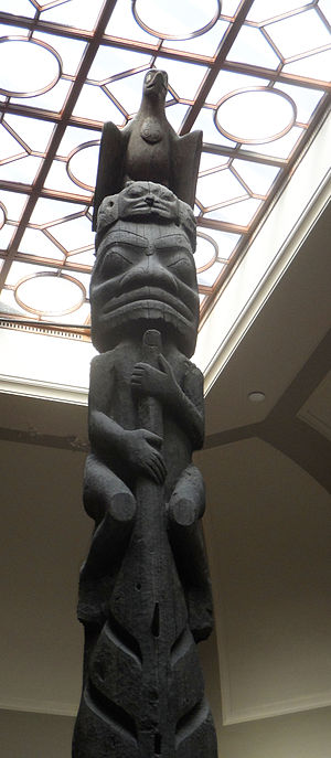 Nisga'a and Haida Crest Poles of the Royal Ontario Museum - Top and upper section of Sag̱aw̓een Pole Man Underneath and Shark