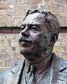 Sir Nigel Gresley statue at King's Cross Station, London, England, head detail.jpg