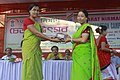 Smt. Rina Debbarma, Chairperson, Sub-Zonal Committee under Tripura Tribal Areas Autonomous District Council (TTAADC) giving away prize to the stall manager of Health Deptt.jpg