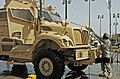 Soldiers wash down MaxxPro for transport.jpg