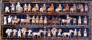 "Ur - The Standard of Ur mosaic, from the royal tombs of Ur, is made of red limestone, bitumen, lapis lazuli, and shell. The ""peace"" side shows comfort, music, and prosperity."